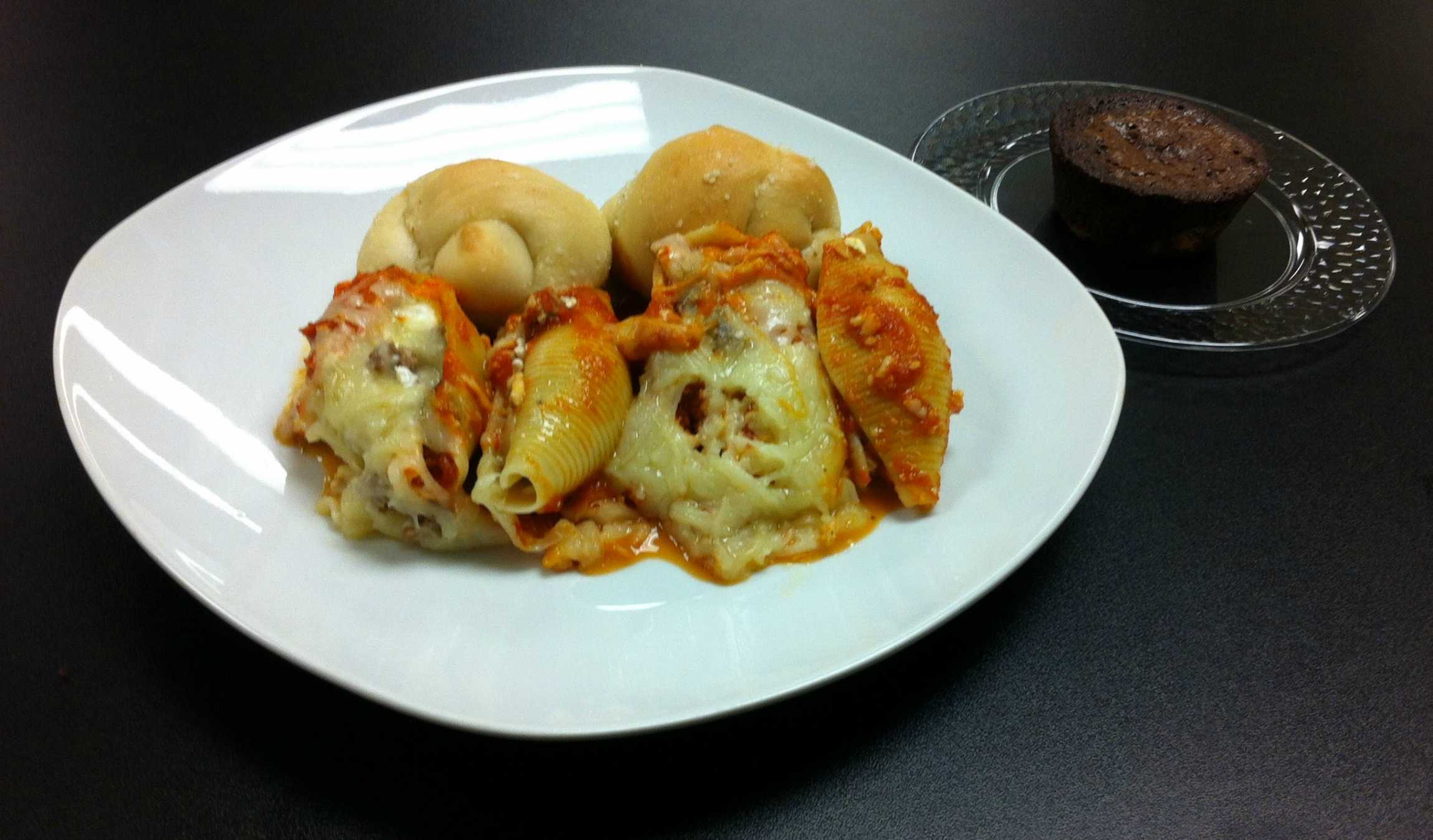 The latest meal: meat and veggie stuffed shells, garlic bread knots, and brownies.