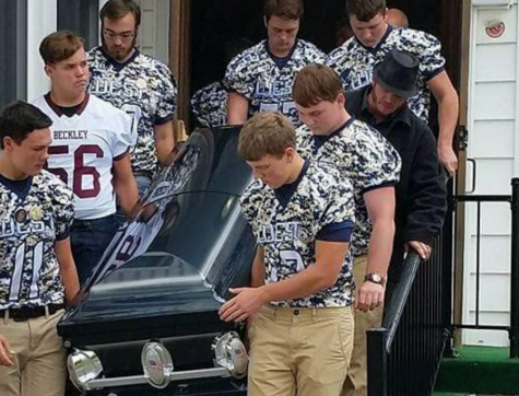 Senior Football players serving as Coach G's pallbearers. Courtesy of WV Metro News.