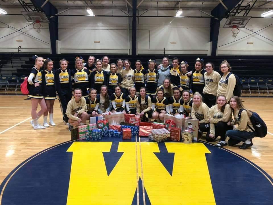 Girls basketball and cheerleading giving back this Christmas!